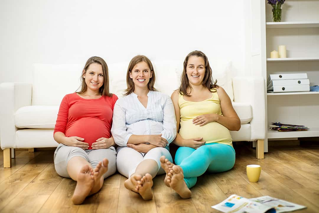 graphicstock-three-pregnant-women-sitting-in-front-of-